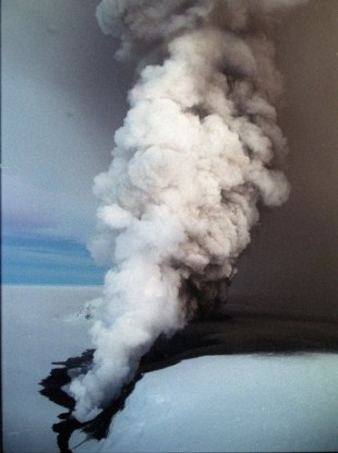 Clouds of steam spewing through a crevasse in Vatnajokull glacier, near Grimsvotn