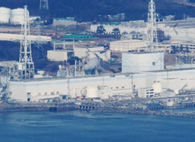 An aerial photograph of the Fukushima I plant, taken while engineers attempte