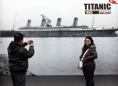 Tourists look at an exhibition in Belfast to mark this year's centenary of the Titanic's launch