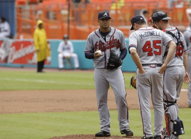 Atlanta Braves pitching coach Roger McDowell, right, unleashed a torent of gay slurs at San Francisco spectators..