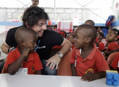 McIlroy with pupils at the Unicef-supported Ecole Joyeux Lutins in Port au Prince