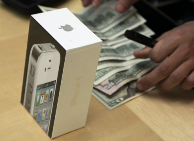 An Apple store employee in New York takes payment for an iPhone 4 earlier this year.