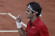 Fed Express rolls on as Djokovic's streak grinds to a halt
