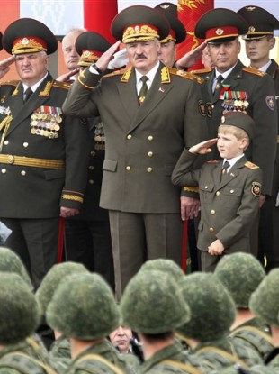 Belarus President Alexander Lukashenko, front centre, with his youngest son Nikolai, right, during a parade marking Independence Day in Minsk today.