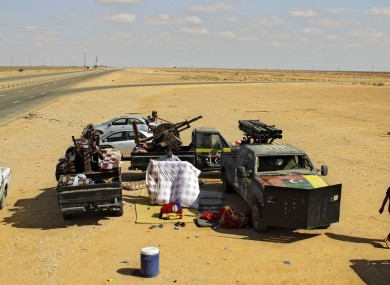 A rebel fighter packs his bed at a checkpoint 80km from Misrata.
