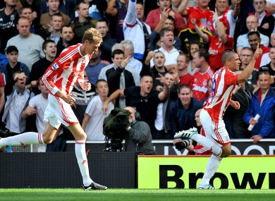 Jon Walters celebrates his penalty against Liverpool with Peter Crouch tailing