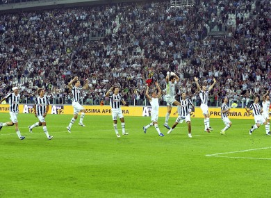 Juventus players celebrate their 2-0 win over AC Milan.
