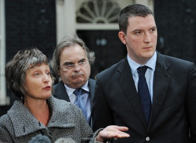 The family of murdered solicitor Pat Finucane, including his widow Geraldine and son John (right) stand with their solicitor John Madden outside 10 Downing Street earlier.