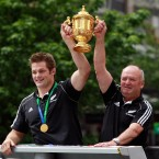 McCaw and coach Graham Henry (right) hold the World Cup aloft.