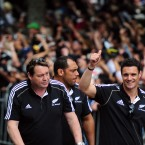 The injured Dan Carter (right) gives the crowd a thumbs up.