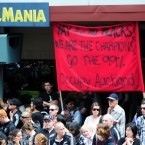 A tongue-in-cheek banner calls on the All Blacks fans to #OccupyAuckland.