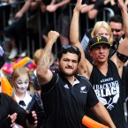 Scrum-half Piri Weepu leads the celebrations.
