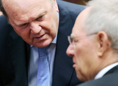 Michael Noonan and his German counterpart Wolfgang Schauble: a briefing document prepared by Schauble's ministry says Ireland will miss its 2013 targets for cutting the deficit.