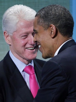 Former US President Bill Clinton and President Barack Obama embrace at the Clinton Global Initiative, Wednesday, Sept. 21, 2011, in New York