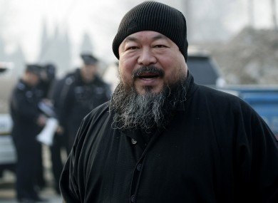 In this Nov. 17, 2010 file photo, artist Ai Weiwei arrives at the Wenyuhe court to support fellow artist Wu Yuren during his trial in Beijing.