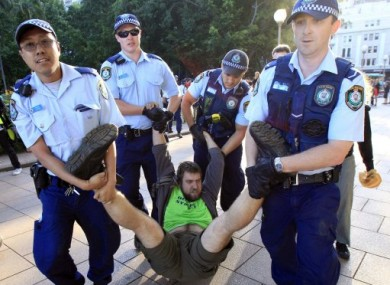 A protester being taken away by police from a protest in Sydney at the weekend