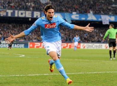 Edison Cavani celebrates scoring against Man City last night.