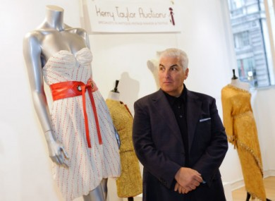 Mitch Winehouse stands by his late daughter's dress ahead of its auction today.