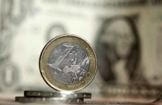 Euro falls to 11-month low against dollar