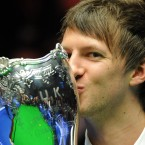 Judd Trump celebrates beating Northern Ireland's Mark Allen in the UK Championships in York.