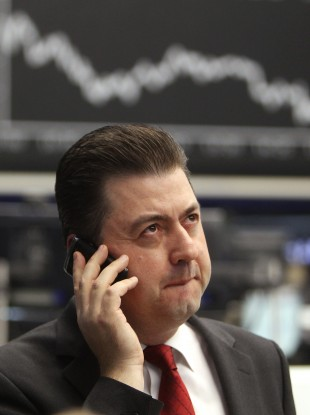 A trader makes a phone call at the stock market in Frankfurt today when the German stock index DAX went down more than two per cent.