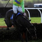 Colm McCormack on Patavium is covered in mud during the Wensley Amateur Riders Hurdle at Catterick Racecourse on Tuesday.