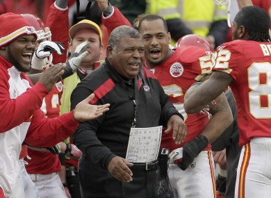 Kansas City Chiefs head coach Romeo Crennel celebrates with his team.