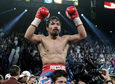 Manny Pacquiao celebrates beating Juan Manuel Marquez in November.