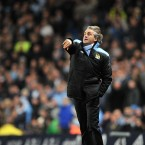 Manchester City manager Roberto Mancini throws the ball back onto the pitch during his side's 1-0 defeat to Liverpool at Eastlands on Wednesday night.