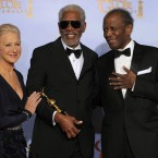 Actor Morgan Freeman poses backstage with the Cecil B. Demille Award with Helen Mirren and Sidney Poitier. (AP Photo/Mark J Terrill/PA Images)