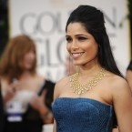 Frieda Pinto arrives for the 69th Annual Golden Globe Awards. (AP Photo/Chris Pizzello/PA Images)