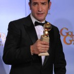The Artist actor Jean Dujardin does his best 'Blue Steel' pose backstage with the award for Best Motion Picture - Comedy or Musical. (AP Photo/Mark J Terrill/PA Images)