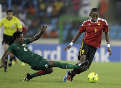 Angola's Manucho, right, is challenged by Burkina Faso's Mamadou Tall