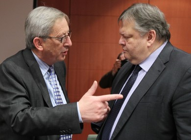 Jean Claude Juncker, left, talks to Greek finance finister Evangelos Venizelos.