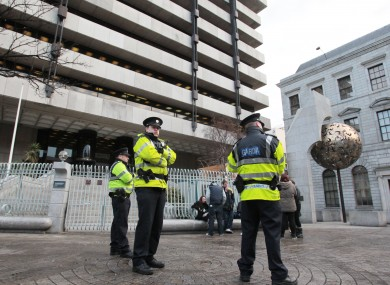 Gardaí and protesters outside the Central Bank today.