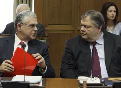 Greek PM Lucas Papademos and Finance Minister Evangelos Venizelos at cabinet meeting in Athens today.
