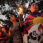 Tibetan exiles participate in a candle light procession to mark the unsuccessful revolt against China in 1959, in Gauhati, India. (AP Photo/Anupam Nath)
