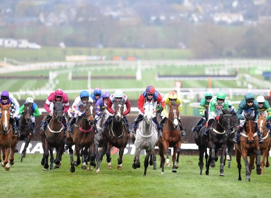 Runners and riders in the JLT Specialty Handicap Chase on Centenary Day, during the Cheltenham Festival.