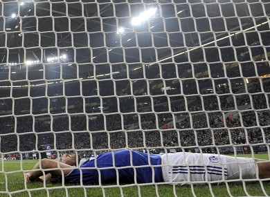 Schalke's Christian Fuchs lies in the goal during last night's 4-2 Europa League defeat at home to Athletic Bilbao.
