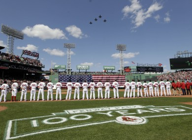 Red Sox players line up to welcome the Vermont N