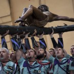 Members of the Spanish Legion, an elite unit of the Spanish Army, hold up the El Cristo de la Buena Muerte, or Christ of the Good Death, during a ceremony ahead of the procession in Malaga, Southern Spain (AP Photo/Emilio Morenatti)