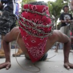 A Filipino penitent wears a crown of barb wire during Good Friday rituals at the municipality of Paombong, Philippines (AP Photo/Aaron Favila)