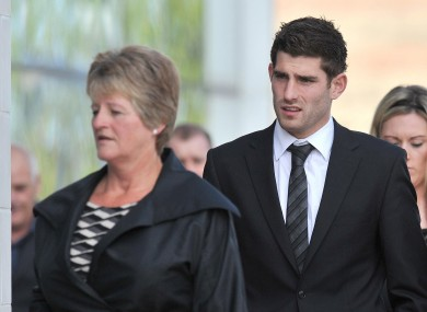 Sheffield United and Wales striker Ched Evans (centre) arrives at Caernafon Crown Court this morning.