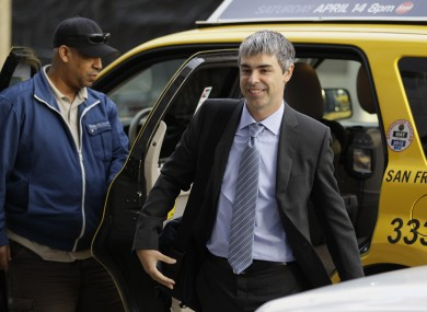 Google CEO Larry Page walks into a federal building in San Francisco earlier today to continue giving evidence in a case against his company.