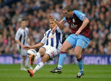 West Bromwich Albion's Peter Odemwingie is challenged by Aston Villa's Richard Dunne.