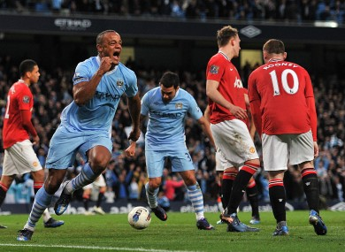 Lift-off: Vincent Kompany gives City the lead... in every sense