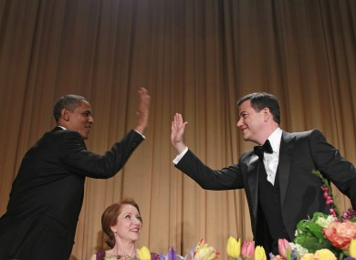President Barack Obama high-fives late-night comic Jimmy Kimmel as Caren Bohan, a Reuters journalist and president of the White House Correspondents' Association looks on
