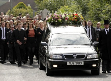 Mourners gathered for the funeral of Marion Graham in August 2011.