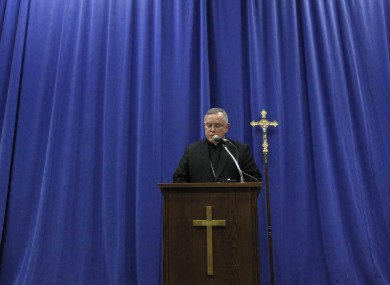 Archbishop of Philadelphia Charles Chaput reads his statement yesterday