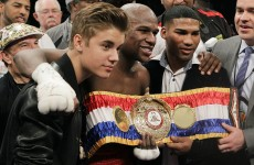 Mayweather overcomes Cotto, poses with Justin Bieber